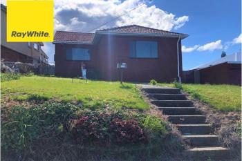 258 Northcliffe Dr, Lake Heights, NSW 2502